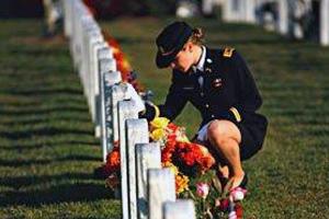 Jenna Grassbaugh visits her husband's grave at Arlington.